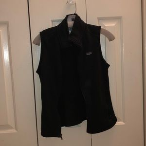 black Patagonia vest with two zip up pockets
